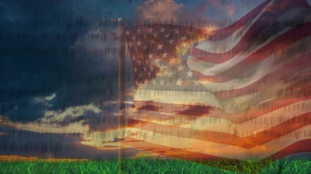 написанный : Digital animation of the written constitution of the United States moving in the screen while American flag waves in pole. Background shows field with grass and the sky with clouds during sunset.