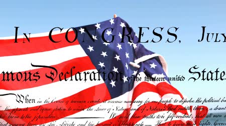 glória : Digital composite of man holding American flag while written declaration of independence of the United States moves in the foreground