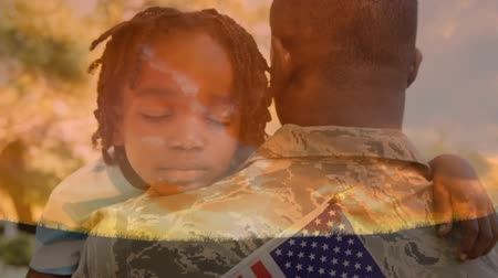 saluto militare : Digital composite of African-American military man in uniform carrying African american child holding American flag outdoors and background of the sky with clouds.