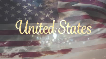 タグクラウド : Digital animation of gold United States text with bokeh lights and an American flag waving. Background shows the sky with clouds.