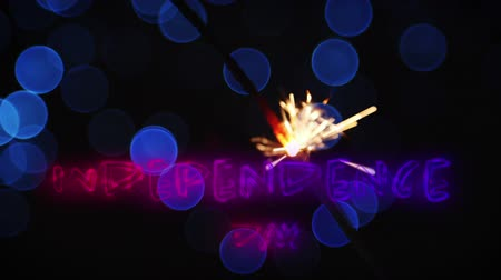 escrito : Digital animation of an Independence day text in red and blue gradient appearing in a dark background with blue bokeh lights and a lighted sparkle flickering for fourth of July.