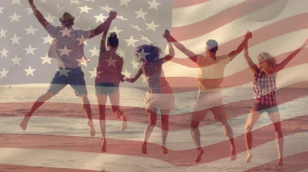 spangled : Digital composite of group of diverse friends jumping together at the beach while the American flag waves in the background for fourth of July.