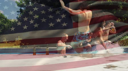 jumped : Digital composite of a group of diverse friends celebrating in a pool and two jumped in while the American flag waves in the background Stock Footage