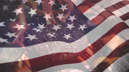 spangled : Digital composite of meat on barbecue on a fire grill while the American flag waves in the background for fourth of July. Stock Footage