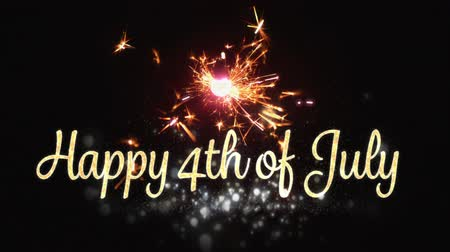 gurur : Digital animation of a gold Happy 4th of July text with bokeh lights while a lighted sparkle flickers in the dark background. Stok Video