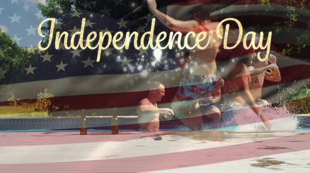usa independence day : Digital composite of group of diverse friends celebrating in the pool and two men jumping in while an American flag waves behind a gold Independence Day text in the background for fourth of July. Stock Footage
