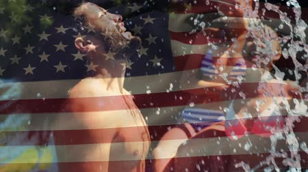 4分の1 : Digital composite of a group of diverse friends having fun in a pool and a man lifting head up from the water while an American flag waves in the background for fourth of July.