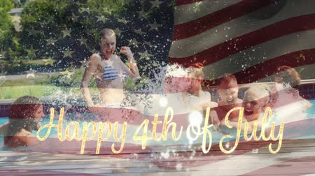 kalligrafie : Digital composite of a group of diverse friends celebrating in a pool while the American flag waves behind a gold Happy 4th of July text Stockvideo