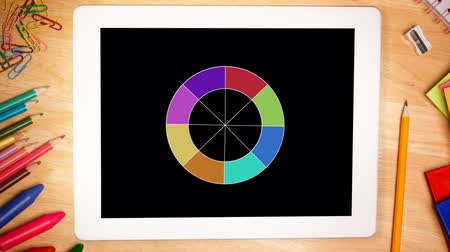 apontador : Animation of circle with colours displayed on a tablet Vídeos