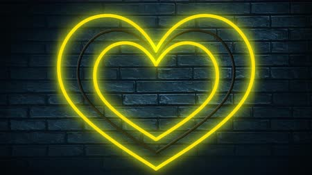 nineties : Animation of neon sign showing yellow and white hearts on dark brick wall Stock Footage
