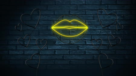 заигрывание : Animation of neon sign showing lips and hearts on dark brick wall Стоковые видеозаписи