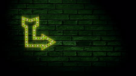 indicar : Animation of neon sign showing arrow on dark brick wall
