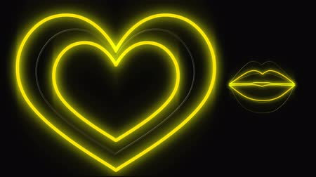 nineties : Digital animation of glowing led lights shaped into a beating heart and moving lips. The background is black