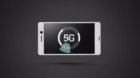 fazer upload : Digital animation of a smartphone with 5G text on its screen. The 5G text is in a circle with rotating pieces rotating along its edge