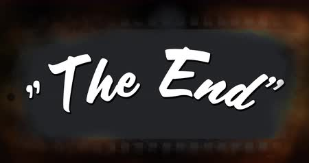 antiquado : Digital animation of a white The End sign appearing in a background of an old film real with black center