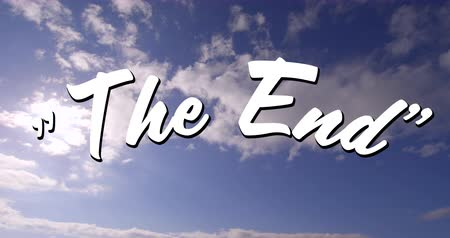 finale : Digital animation of a white The End sign appearing in the screen with a background of the sky with clouds during the day