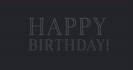 doğum günü : Digital animation of a Happy Birthday text in blue and violet fonts flickering while gold confetti fall against a dark grey background Stok Video