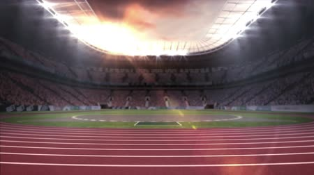 brilhantemente : Digital animation of a running stadium with gold confetti. Spot lights are brightly glaring on the stadium roof