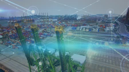 přístav : Digital composite of a high angle view of a shipping dock. The foreground has connected lines and blinking dots. The docks has cargo containers and cranes Dostupné videozáznamy