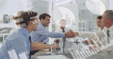 számvitel : Digital composite of diverse business people smiling and shaking hands in an office while different graphs move in the foreground