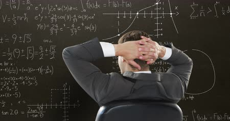 산출 : Digital composite of a Caucasian male student with hands at the back of his head while mathematical equations with figures move in the screen video for back to school.
