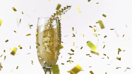 colar : Digital composite of a gold necklace dropping in a glass of wine. Digital gold confetti is falling against a white background