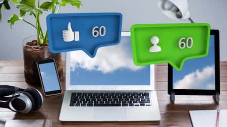感想 : Digital animation of like and follow icon with increasing count in message bubbles. The background are mobile devices beside a plant and a headset on a wooden table for social media