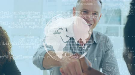 alcançando : Digital composite of a Caucasian man shaking hands with an African american during a business meeting. A rotating globe is in the middle f the foreground with program codes Vídeos