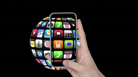 videotape : Digital animation of a spinning globe globe with apps and icons on its surface. On the foreground is a hand holding up a smartphone videotaping the globe Stock Footage