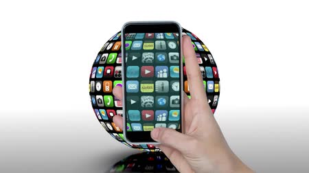videotape : Digital animation of a rotating globe with apps and icons. On the foreground is a hand holding up a phone while videotaping
