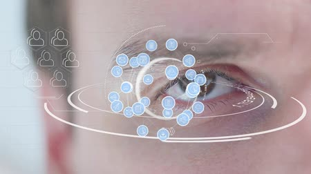courriel : Digital animation of different application icons in circles connected by asymmetrical lines and arranged in a sphere and profile icons in hexagons. Background shows an eye of a Caucasian man blinking.