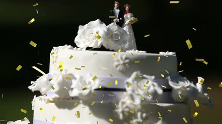 wedding cake : Digital composite of a wedding cake placed outdoors while gold confetti fall in the screen