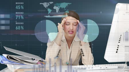 aflição : Digital composite of a Caucasian woman looking stressed with a lot of work on the desk. Different graphs move in the foreground with values. Stock Footage
