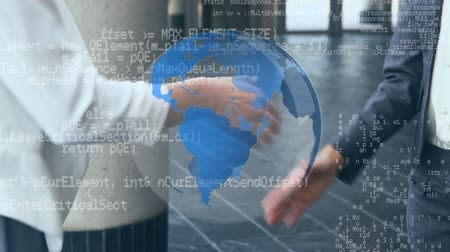 comando : Digital composite of two businessmen shaking hands with a globe rotating and program codes moving in the screen