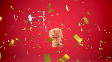 luftschlangen : Digital animation of a cork and gold confetti falling in the screen against a red background