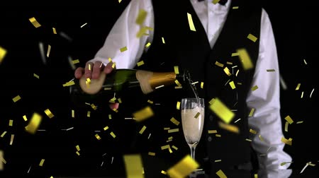flétna : Digital composite of a Caucasian waiter pouring champagne in a glass while gold confetti fall in the screen.