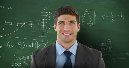 matemático : Animation of the head and shoulders of a smiling Caucasian man facing the camera and looking up, standing in front of a chalkboard with moving mathematical graphs and formulae written in chalk behind him 4k