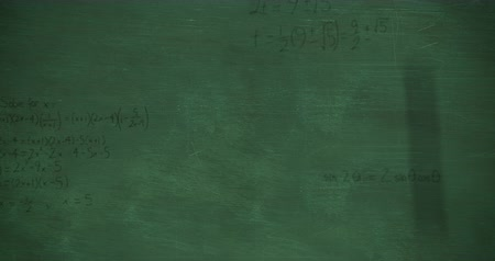 formulae : Animation of layers of handwritten mathematical calculations in black falling towards a green chalkboard background 4k Stock Footage