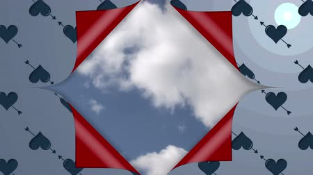 desenli : Animation of blue heart and arrow patterned wallpaper opening from the centre to reveal red underside and a blue sky with moving white clouds and a lens flare in top right corner, before closing up again