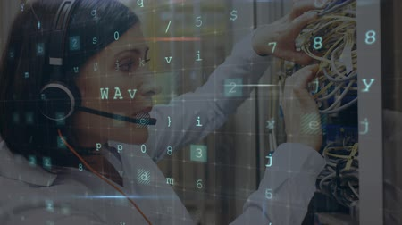 administrador : Animation of a the side view Caucasian woman seen close up wearing a headset and talking on the phone and checking connections in a computer server room, while glowing digital text about computer security flashes and moves in the foreground