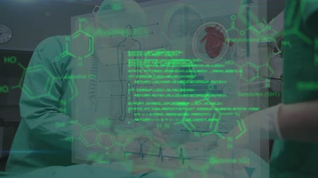 fyziologie : Animation of two surgeons operating on a patient in an operating theatre, one seen waist up, the other in mid section, while glowing green data and diagrams move in the foreground