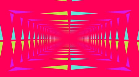 kinetik : Animation of bright neon triangles travelling to and from a central vanishing point on bright pink background Stok Video