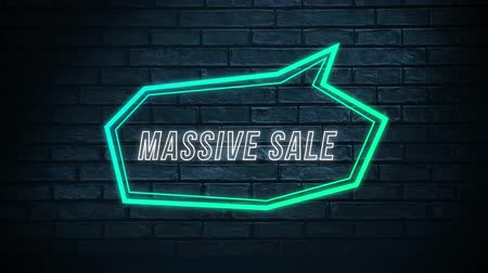 угловой : Animation of the words Massive Sale in white outline letters in a neon green angular speech bubble against a dark brick wall