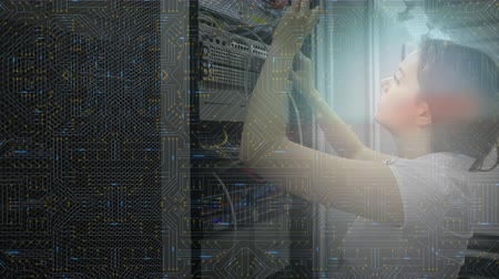 szervez : Animation of a Caucasian woman plugging in cables in a computer server room, turning and smiling to camera, while a motherboard with glowing elements scrolls in the foreground