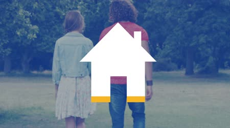 parky : Animation of the back view of a young Caucasian couple walking hand in hand across a field while an empty house icon fills with yellow until almost complete Dostupné videozáznamy