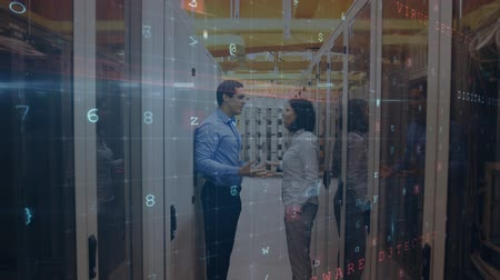 szervez : Animation of Caucasian man and woman seen side on having a heated discussion in the corridor of a server room between racks of mainframe computers while digital text about data security moves and flashes in the foreground