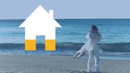 érték : Animation of a Caucasian couple embracing on a beach by the sea, while an empty icon of a house fills with yellow