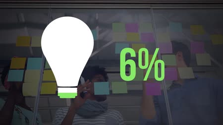 sıfır : Animation of light bulb shape and percent increasing from zero to sixty one filling in green with colourful notes on the office wall in the background