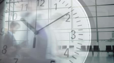 pace : Animation of people walking across office lounge in fast motion with ticking clock in the foreground