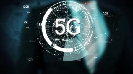 развертка : Animation of 5g displayed in a rotating circle with data spinning and businessman touching the cirlce in the background
